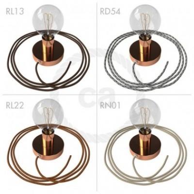 Spostaluce, fuente de luz de metal cobre con cable textil y orificios laterales